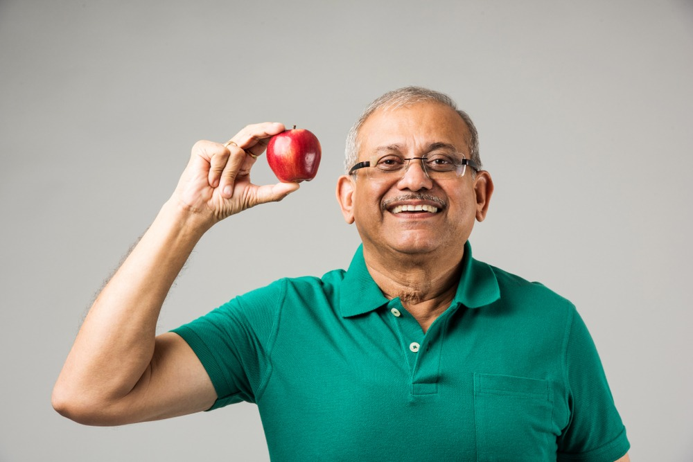 mature man with dentures can eat an apple