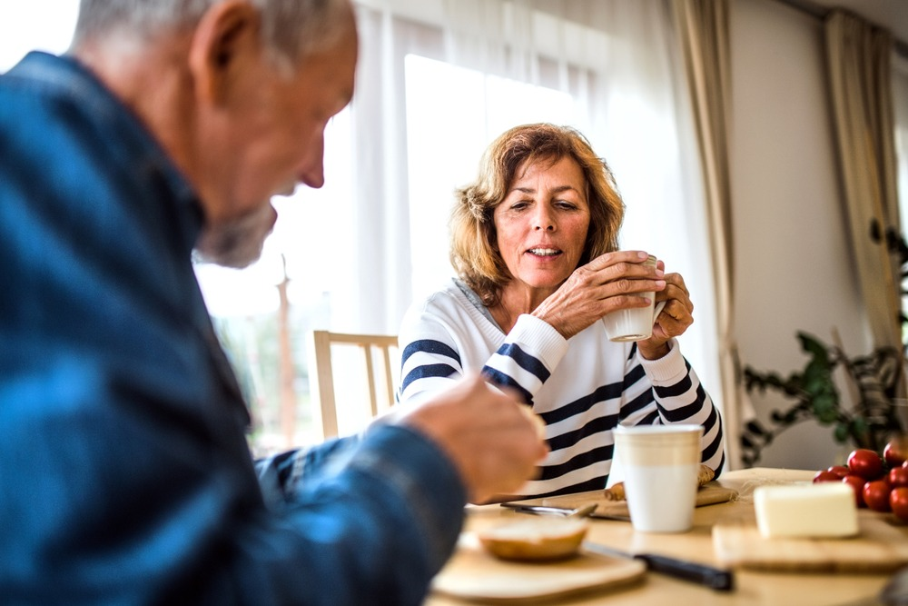 mature couple having meal together