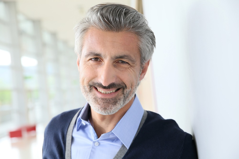 man in 50s smiling
