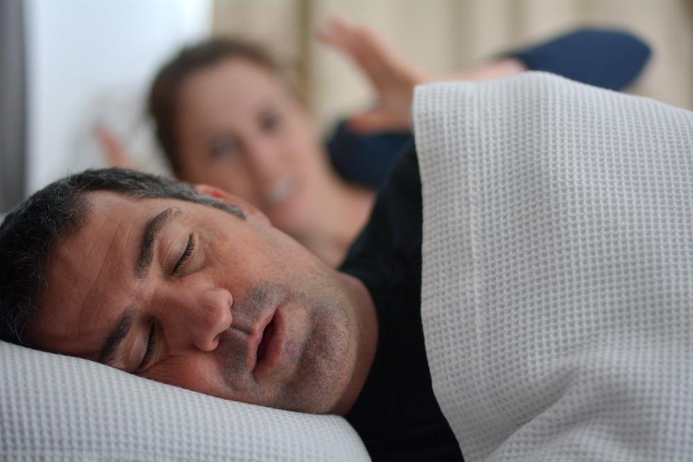 snoring man keeps wife awake