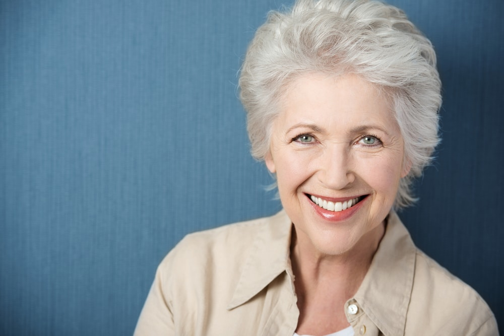 mature woman with dentures smiling