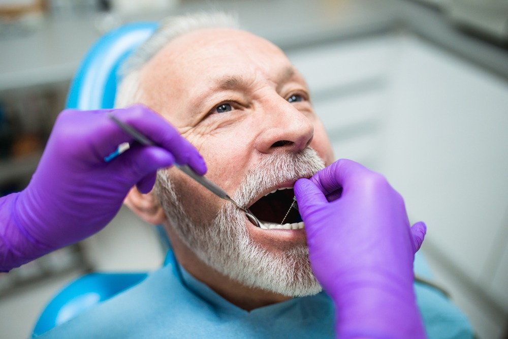 man gets oral hygiene checkup