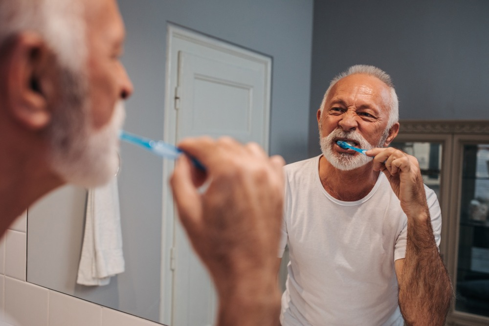 man brushing teeth for oral health