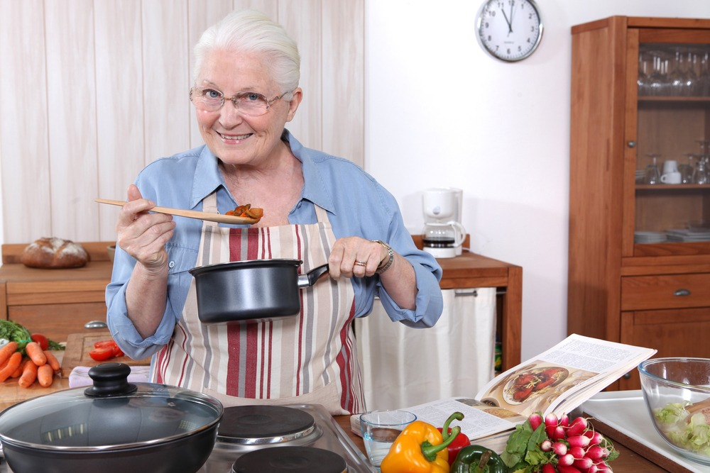 senior woman cooks holiday meal