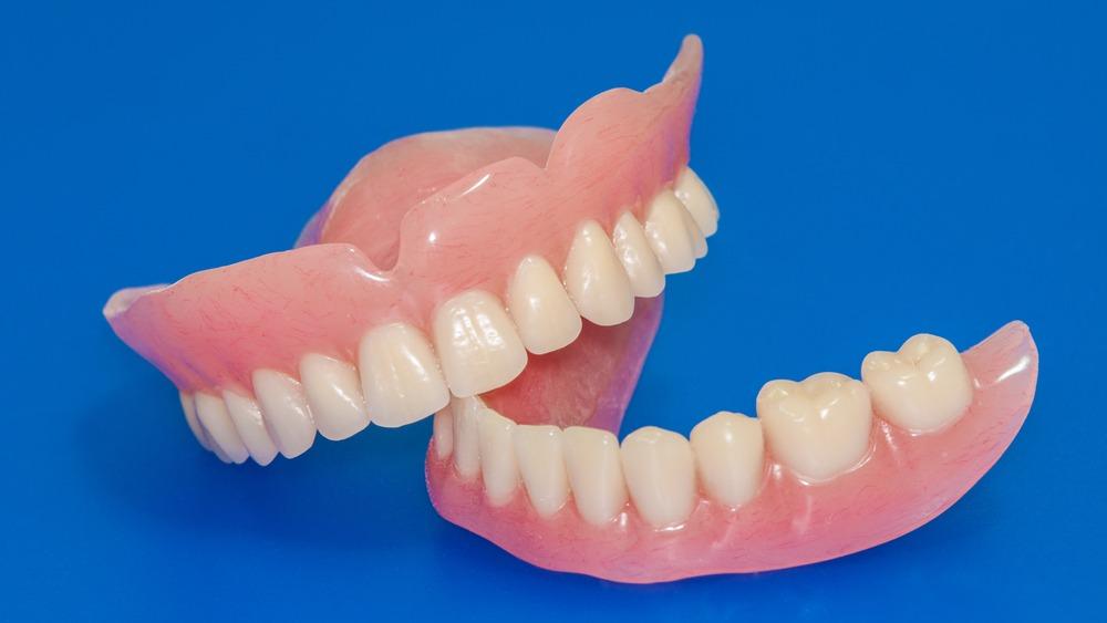 dentures on BLUE background