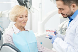 denturist and dental patient in denture clinic